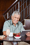 Happy senior man with tablet computer Royalty Free Stock Photo