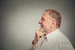 Happy senior man thinking Royalty Free Stock Images