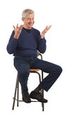 Happy senior man with upraised hands Royalty Free Stock Images