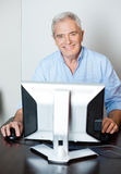 Happy Senior Man Using Computer In Class Stock Photography