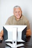 Happy Senior Man Using Computer In Classroom Stock Image