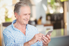 Happy senior man using mobile phone Stock Photos