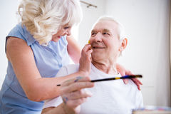 Happy senior man and woman in art workshop Stock Photos