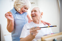 Happy senior man and woman in art workshop Royalty Free Stock Photos
