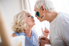Happy senior man and woman in art workshop Royalty Free Stock Image