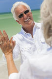 Happy Senior Man Woman Couple Dancing on Beach Stock Photo