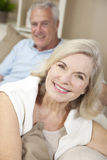 Happy Senior Man & Woman Couple Smiling at Home. Happy senior men and women couple sitting together at home smiling and happy stock image