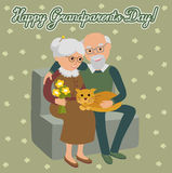 Happy senior man woman family sitting on the sofa with cat. Greeting card for grandparents day. Royalty Free Stock Photography