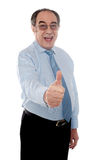 Happy senior manager posing with thumbs-up gesture. Handsome senior manager gesturing thumbs-up at you against white background Stock Photo