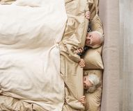 Happy senior married couple having nap at home stock image