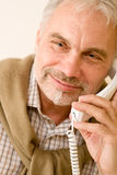 Happy senior mature man on the phone Stock Photos