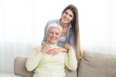 Happy senior mom and her daughter spending time at home royalty free stock photography