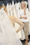 Happy senior mother admiring her daughter dressed up in wedding gown Stock Photography