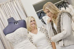 Happy senior mother looking at young daughter in bridal store Royalty Free Stock Images