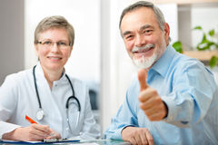 Doctor and patient. Happy senior patient and doctor at the doctor's office Stock Photos