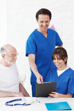 Happy senior patient and doctors Royalty Free Stock Image