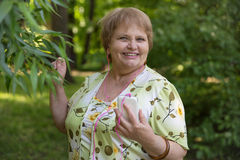 Happy senior pensioner having fun with mobile and headphones Royalty Free Stock Photos