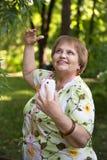 Happy senior pensioner having fun with mobile and headphones Stock Photos