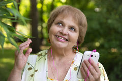 Happy senior pensioner having with mobile and headphones Stock Photos