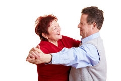 Happy senior people dancing. Two happy senior people dancing a waltz Royalty Free Stock Photos