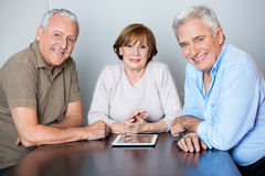 Happy Senior People With Digital Tablet In Classroom Royalty Free Stock Photos