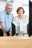 Happy Senior People Using Computer In Class Stock Images