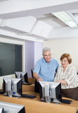 Happy Senior People Using Computer In Classroom Royalty Free Stock Photo