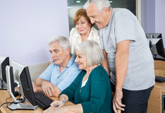 Happy Senior People Using Computer Together In Class Stock Images
