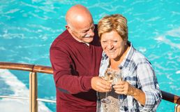 Happy senior retired couple having fun outdoors at travel vacation stock image