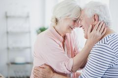 Happy senior spouses hugging Stock Images