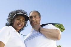 Happy Senior Tennis Couple Royalty Free Stock Photos