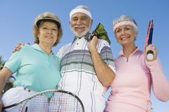 Happy Senior Tennis Players Smiling royalty free stock photography