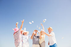 Happy senior throwing money Stock Photography