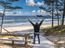 Happy senior tourist is resting near a beach of the Baltic Sea Stock Images