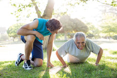 Happy senior training with a coach Royalty Free Stock Images