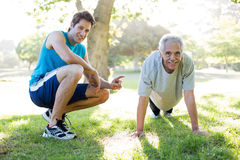 Happy senior training with a coach Stock Photography