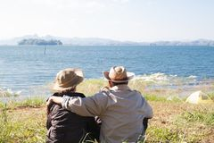 Happy senior travelers sitting together in nature, Healthy senio royalty free stock photography