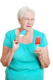 Happy senior with two ice cream popsicles Stock Photo