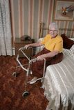 Happy senior with walker. Senior at pension with a walker in a bedroom Stock Images