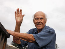 Happy Senior Waving Outside stock photography
