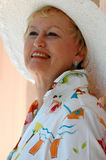 Happy senior woman. A smiling senior woman in a sun hat royalty free stock photography