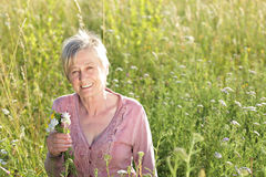 Happy senior woman active in nature Stock Photos