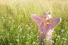 Happy senior woman active in nature. In summer stock images
