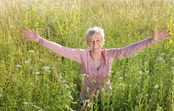 Happy senior woman active in nature. In summer royalty free stock images