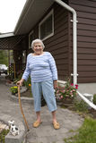 Happy Senior Woman in Back Yard of Home stock photos