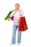 Happy senior woman with bags Royalty Free Stock Photography