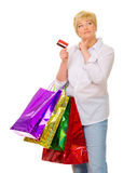 Happy senior woman with bags and credit card Stock Photos