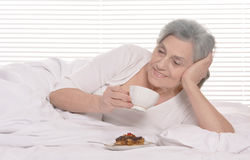 Happy senior woman in a bedroom Royalty Free Stock Photography
