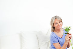 Happy senior woman with bouquet Stock Image