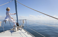 Happy Senior Woman on Bow of a Sail Boat Stock Photography